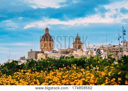 View To St. Lawrence's Church With Orange Flowers In Il-birgu