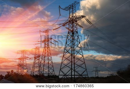 high-voltage power lines. high voltage electric transmission tower at sunset.