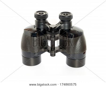 Vintage prism black color military binoculars front view isolated on white studio shot closeup