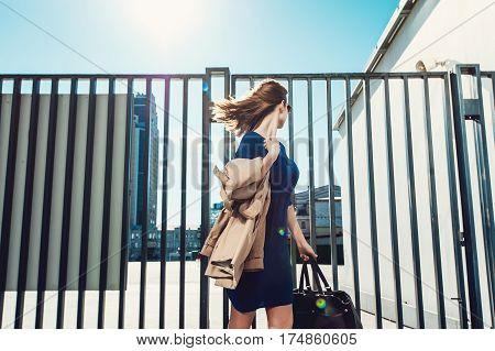 Woman In Dress Walking Outdoors
