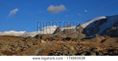 Hiking trail in Zermatt. Findel glacier and moraine. View from Fluhalp.