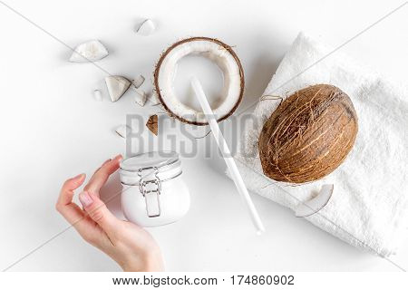 organic cosmetics with coconut on white background top view.