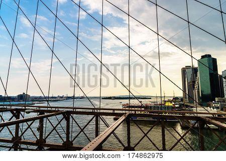 Brooklyn Bridge across East River to Low Manhattan New York