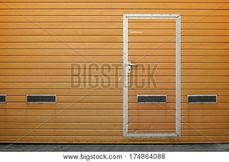 Yellow garage gate with ventilation grilles. Large automatic up and over garage door with inclusion of smaller personal door. Multicolor background set