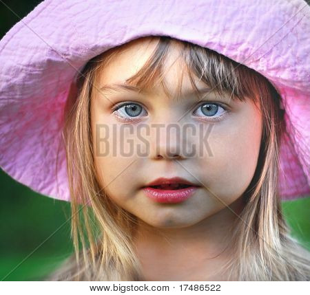 portrait of a girl in pink hat