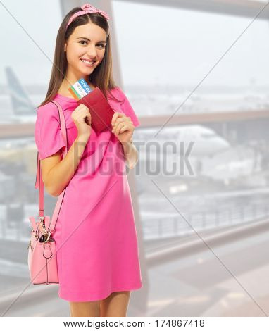 Young travelling woman in airport