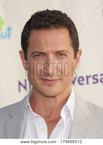 LOS ANGELES - AUG 02:  Sasha Roiz arrives for the Summer 2011 TCA Party-NBC on August 1, 2011 in Beverly Hills, CA