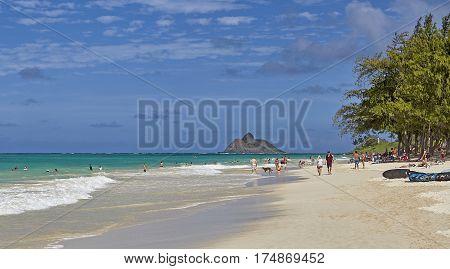 Kailua Beach, Hawaii, USA -- August 1, 2016: Locals and tourists on the shores of Kailua Bay Hawaii