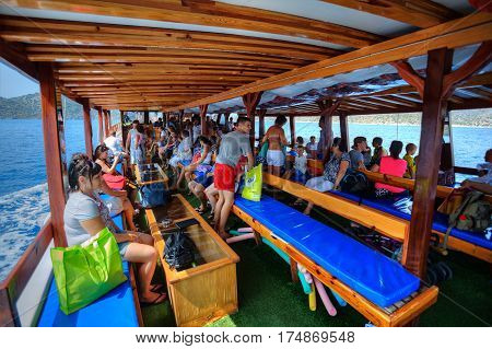 Antalya Turkey - 28 august 2014: Many passengers sitting aboard tourist yacht during the excursion trip in the Mediterranean Sea.