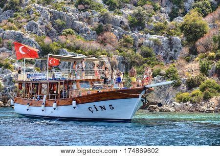 Antalya Turkey - 28 august 2014: Small cruise vessel with many tourist on Mediterranean sea sightseeing excursion Kekova island boat tour.
