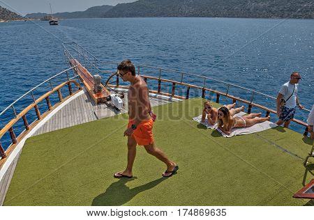 Antalya Turkey - 28 august 2014: Boat trip near Antalya coast tourists take sun baths or stroll along the deck of the ship.