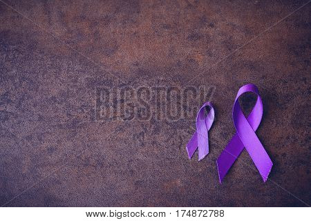 Purple ribbonstoning copy space background Alzheimer's disease Pancreatic cancer Epilepsy awareness Hodgkin's Lymphoma awareness