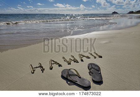Hawaii Beach writing in Sand and Slippers