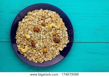 Oatmeal With Nuts(hazelnuts,  Almonds,cashew). Oatmeal On A Wooden Table. Oatmeal Top View. Healthy