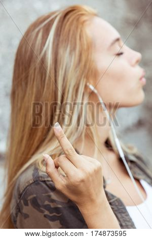 Rude Gesture Of The Middle Finger By Young Woman