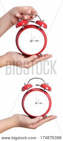 Closeup Shot Of A Woman Holding Red Heartshape Alarm Clock. Close Up Of Female Hands Holding A Red A