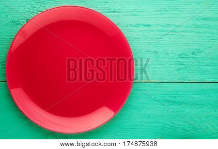 Plate On A Wooden Background.red Plate. Plate Top View. Copy Space