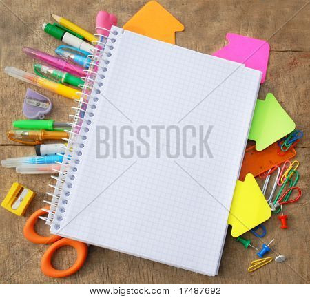 School or office tools on wooden board