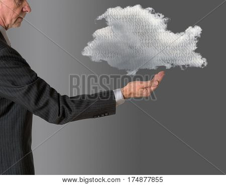 Senior male caucasian executive with floating cloud computing shape. Connection to electronic records via WiFi to web services applications