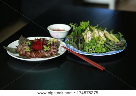 Steamed Dog Meat With Herbs And Sauces In Vietnam
