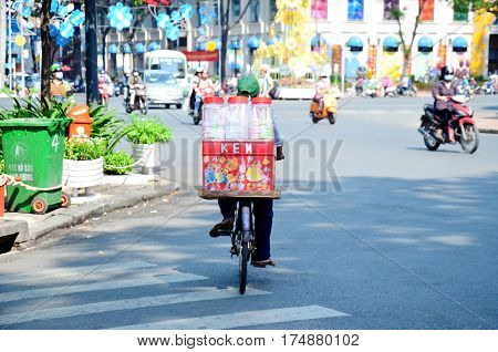 Vietnamese People Riding Bicycle On The Road
