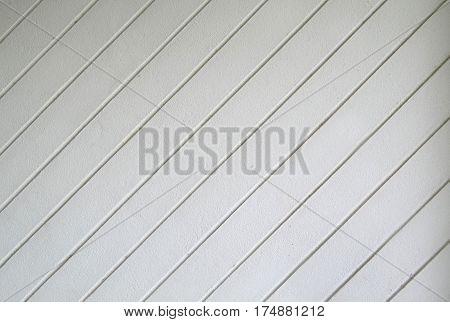 White cement wall with diagonal line for background and texture