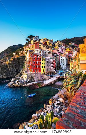 Riomaggiore town cape and sea landscape at sunset. Seascape in Cinque Terre National Park Liguria Italy Europe.
