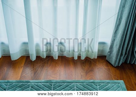 Transparent curtain on window. Curtain background,light shine through the curtain,Close up of draperies at a window.