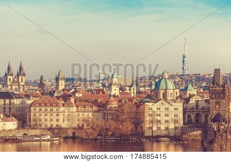 Old town of Prague, Czech Republic over river Vltava with cathedral and Charles bridge on skyline. Bright sunny day blue sky. Praha panorama landscape view.