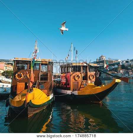 PORTO, PORTUGAL - DEC 26, 2016: Wooden historic boats at Douro river, in area Ribeira. City of Porto was elected from 20 selected Best European Destination 2017 and won this prestigious title.
