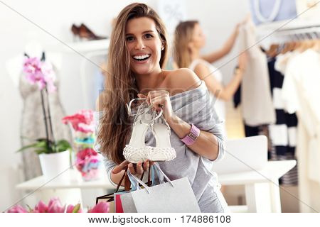 Happy woman shopping for shoes