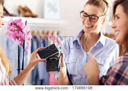 Female customer paying in shop with credit card