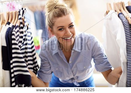Happy woman shopping for clothes