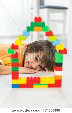 Child making a new dream home with a car