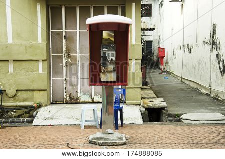 Old And Dirty Public Telephone Or Payphone Booth Malaysian Style