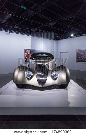 Los Angeles CA USA -- March 4 2017: Champagne colored 1936 Ford Roadster Impression at the Petersen Automotive Museum in Los Angeles California United States. Editorial only.