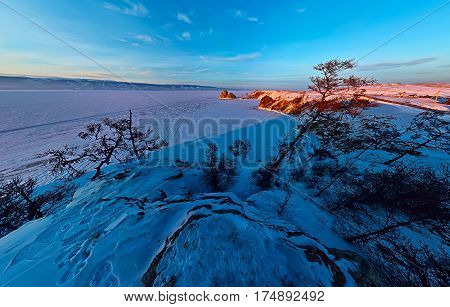Wide Aerial Shaman Rock Cape At Dawn On The Island Of Olkhon, Lake Baikal