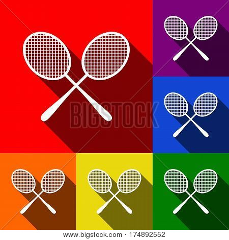 Tennis racquets sign. Vector. Set of icons with flat shadows at red, orange, yellow, green, blue and violet background.