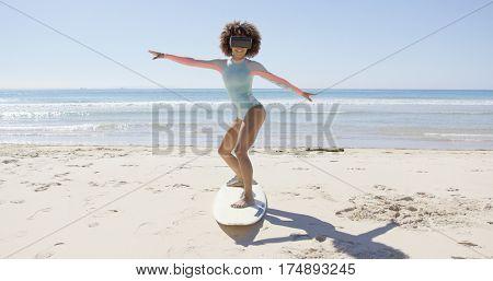 Female wearing virtual reality glasses on beach