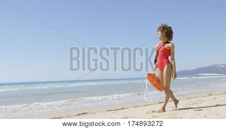 Lifeguard female with rescue float