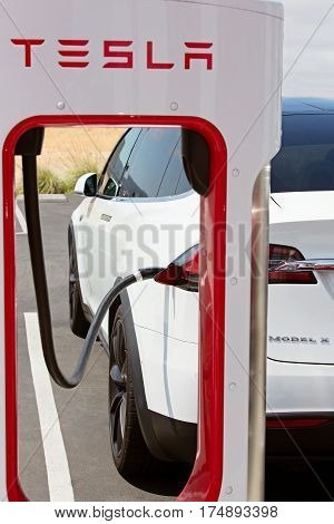 Seaside CA - May 29 2016: white tesla model x charging at supercharger station