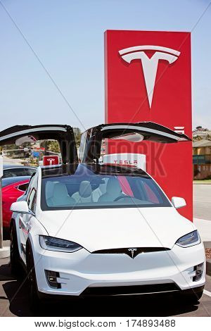 Seaside CA - May 29 2016: white tesla model x with falcon wing doors open parked at supercharger station