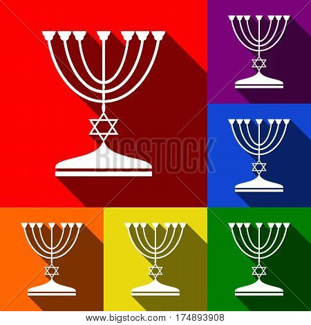 Jewish Menorah candlestick in black silhouette. Vector. Set of icons with flat shadows at red, orange, yellow, green, blue and violet background.