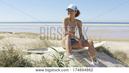 Happy female on a surfboard