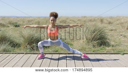 Sporty woman stretching on pavement