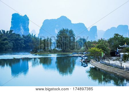 The mountains and river scenery in the mist