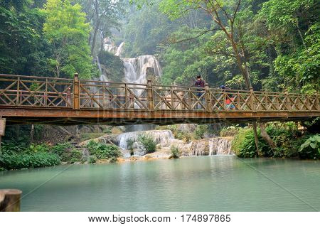 People Travel And Stand On The Bridge Looking And Take Photo Viewpoint Of Kuang Si Falls