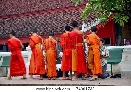 Tradition Of Almsgiving With Sticky Rice By Monks Procession Walk