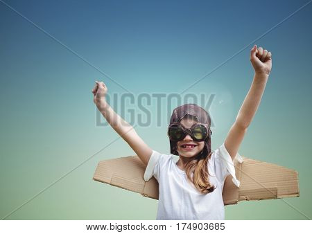 Boy with aviation glasses pretending to be a pilot against blue background