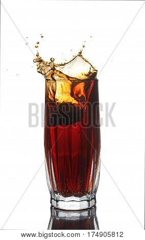 Splash In Glass Of Cola With Lemon
